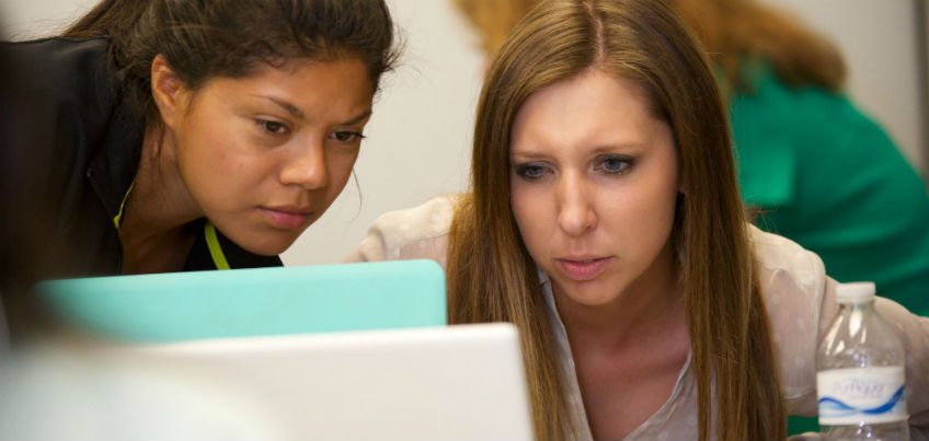 Students looking at a computer