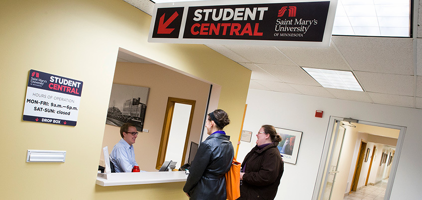 Students at Student Central window