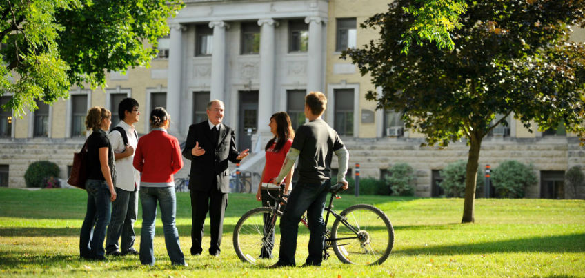 Brother William on campus speaking with students