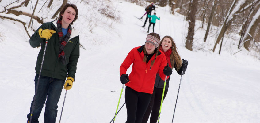 Students being active and skiing