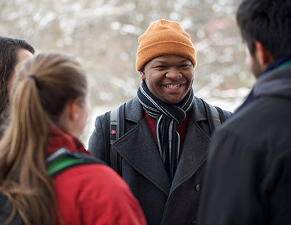 Student in crowd smiling