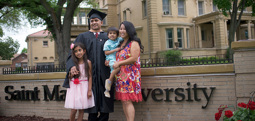 Graduate and his family on campus